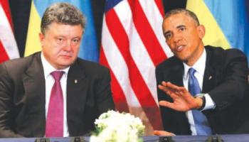 US President Barack Obama, right, meets with Ukraine president-elect Petro Poroshenko in Warsaw, Poland, on Wednesday. — AP