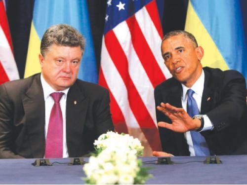 US President Barack Obama, right, meets with Ukraine president-elect Petro Poroshenko in Warsaw, Poland, on Wednesday. — AP