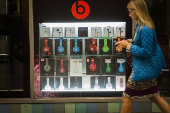 A pedestrian walks past a Beats brand display in the subway system of New York