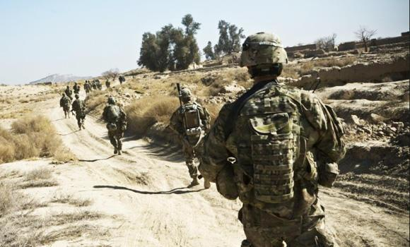 "British soldiers are shown on patrol in Afghanistan's Helmand province in this file photo. A UK Ministry of Defense report says thousands of British soldiers are overweight and ""too fat to fight."""