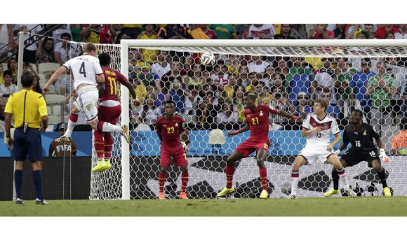Germany's Benedikt Hoewedes (4) heads the ball into the Ghana goal to score his side's second goal during the group G World Cup soccer match between Germany and Ghana at the Arena Castelao in Fortaleza, Brazil, on Saturday.