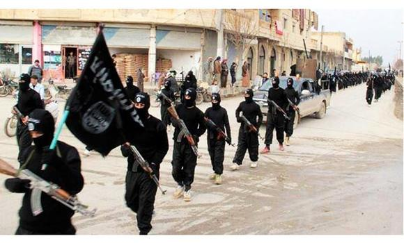 Fighters from the Islamic State of Iraq and the Levant (ISIL) march in Raqqa, Syria, in this undated file image posted on a militant website on Jan. 14, 2014. France on Monday accused the group of selling captured Iraqi oil to the Assad regime in Syria.