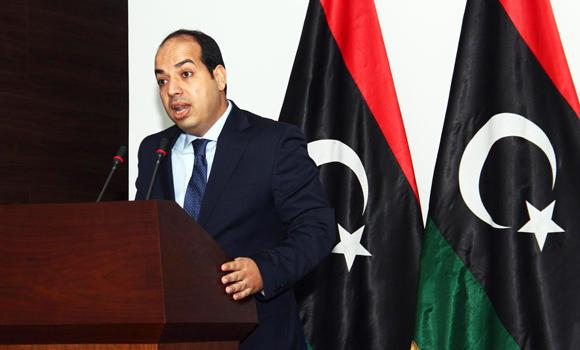 Libya's new premier Ahmed Miitig speaks to the press on Monday in Tripoli. Miitig said he would respect the Supreme Court's ruling that his election to the post during a chaotic parliamentary session had been unconstitutional. (AFP)