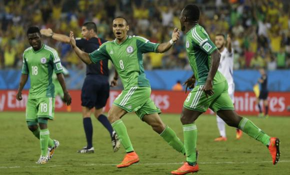 Nigeria's Peter Odemwingie, center, celebrates after scoring his side's opening goal during the group F World Cup soccer match between Nigeria and Bosnia at the Arena Pantanal in Cuiaba, Brazil, on Saturday.