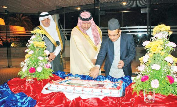 Riyadh Gov. Prince Turki bin Abdullah bin Abdul Aziz cuts the cake with Nepal Ambassador Udaya Raj Pandey to mark the National Day celebration.