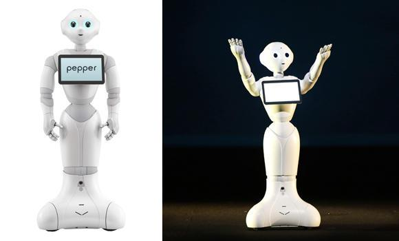 In this combination of photos released by Softbank Corp. shows the Japanese mobile carrier's Pepper humanoid-on-wheels. Softbank is entering the robotics business with its Pepper, developed jointly with Aldebaran Robotics, owned by Softbank, that it says is designed for companionship and can decipher human emotions. (AP Photo/Softbank Corp.)