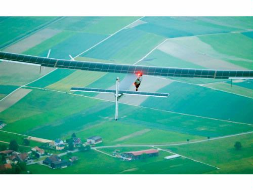 German test pilot Markus Scherdel steers the solar-powered Solar Impulse 2 aircraft for its maiden flight at its base in Payerne, Switzerland Monday Monday. The aircraft is the second solar plane of the Solar Impulse project. The main goal of the project is to circumnavigate the world with an aircraft, powered only by solar energy.