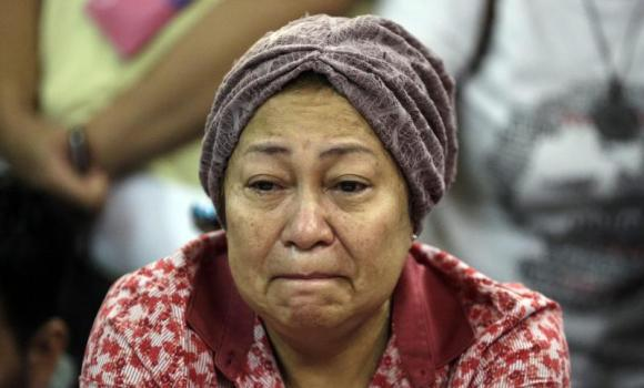 A family member of crashed Malaysia Airlines flight cries at Kuala Lumpur International Airport (KLIA).