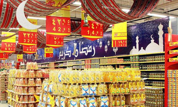 A shopping mall decorated with banners during Ramadan offer.