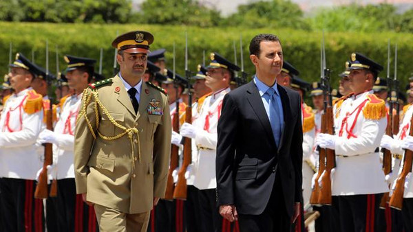 Syrian President Bashar al-Assad (C) reviewing the honor guard, ahead of being sworn in for a new seven-year term.