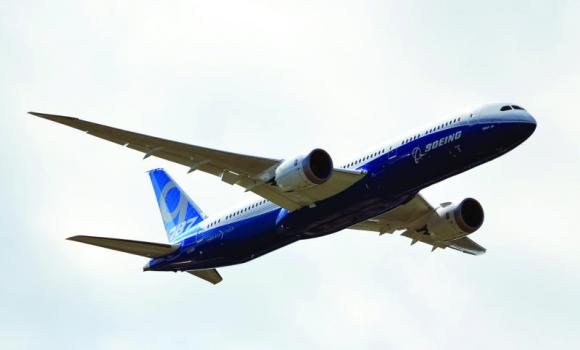 A Boeing 787-9 is pictured during a flight demonstration at the Farnborough air show in Hampshire, England.