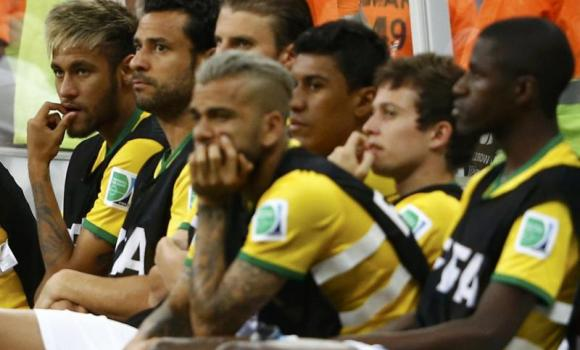 Brazil's Neymar (L) and his team mates watch from the bench during their 2014 World Cup third-place playoff against Brazil at the Brasilia national stadium in Brasilia on Saturday.
