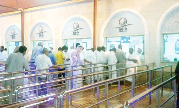 Visitors and pilgrims stand in line at 2:30 in the morning to buy Zamzam water at the main filling station operated by the National Water Company in Makkah.