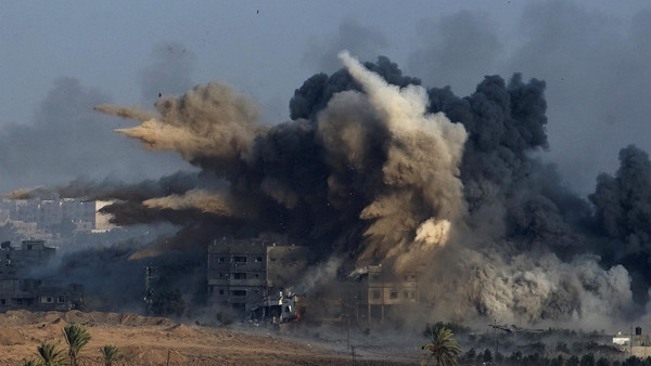 An explosion during an Israeli strike in the northern Gaza Strip is pictured from the Israeli border with Gaza, early morning July 26, 2014.