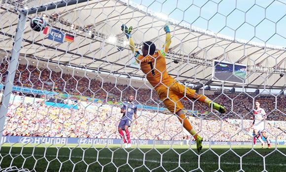 France's goalkeeper Hugo Lloris fails to stop a shot by Germany's Mats Hummels during the World Cup quarterfinal soccer match between Germany and France at the Maracana Stadium in Rio de Janeiro, Brazil, on Friday.