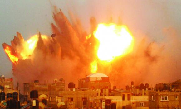 A ball of fire is seen following an early morning Israeli airstrike in Rafah, Gaza, on Saturday.
