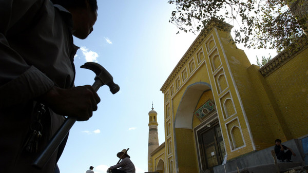 Han Chinese workers refurbish the surrounding areas of the Id Kah Mosque in Kashgar in the southwestern part of China's Xinjiang Uighur Autonomous Region.