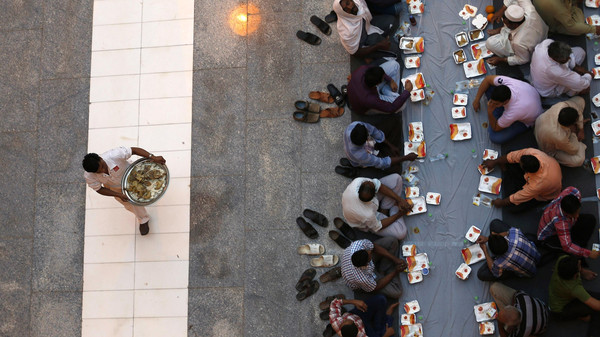 Muslims wait to have their Iftar meal on the first day of the holy fasting month of Ramadan at Prince Turki bin Abdullah mosque in Riyadh.