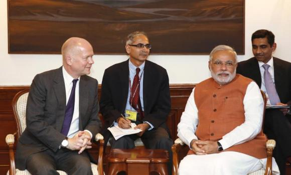 Indian Prime Minister Narendra Modi, right, sits with British Foreign Secretary William Hague.