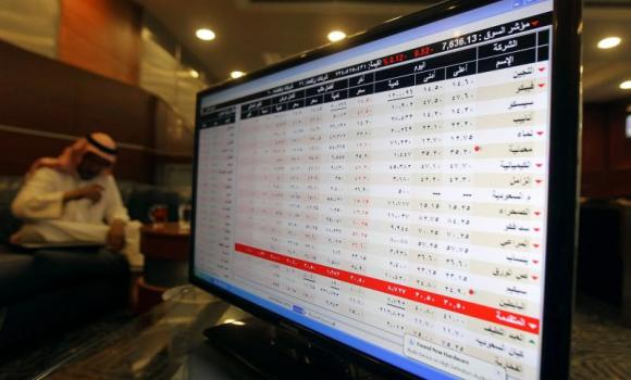 A screen displaying stock market prices is seen at an investment bank in Riyadh.