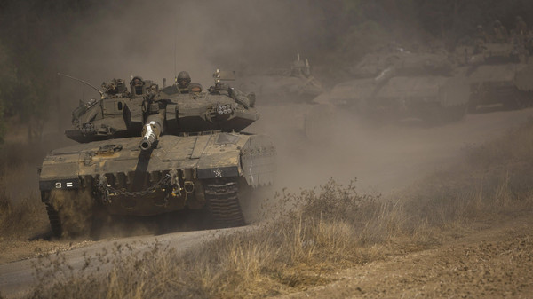 An Israeli convoy manoeuvres outside central Gaza Strip July 19, 2014. Israeli forces on Saturday pressed ahead with a ground offensive in Gaza.