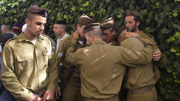 Israeli soldiers mourn during the funeral of their comrade Moshe Malko at the Mount Herzl military cemetery in Jerusalem July 21, 2014.