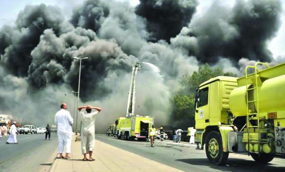 Civil Defense teams battle the blaze in Jeddah's Kilo 8 District on Saturday.