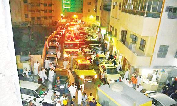 Fire engines and Civil Defense officers outside the affected hotel in the Misfala district of Makkah in the early hours of Wednesday.