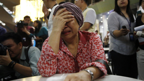 A woman, who said she believed her sister was on Malaysia Airlines flight MH17, cries as she waits for more information about the crashed plane at Kuala Lumpur International Airport in Sepang July 18, 2014.