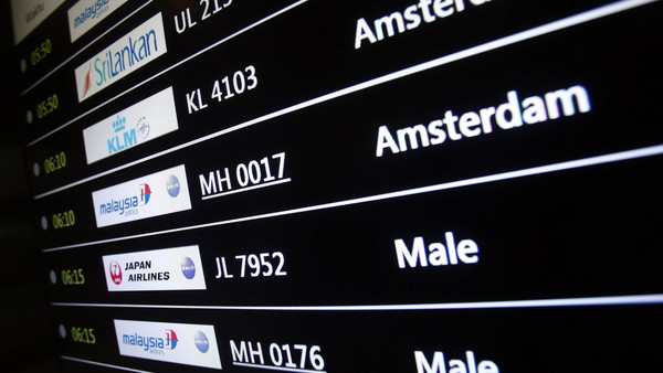A screen showing arrival details of Malaysia Airlines flight MH17 (2nd from top) is seen at Kuala Lumpur International Airport in Sepang July 18, 2014.