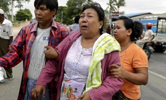 The mother of 36-year old Tun Tun who was killed during the clash between Buddhists and Muslims in Mandalay, cries at the funeral services in Mandalay, Myanmar.