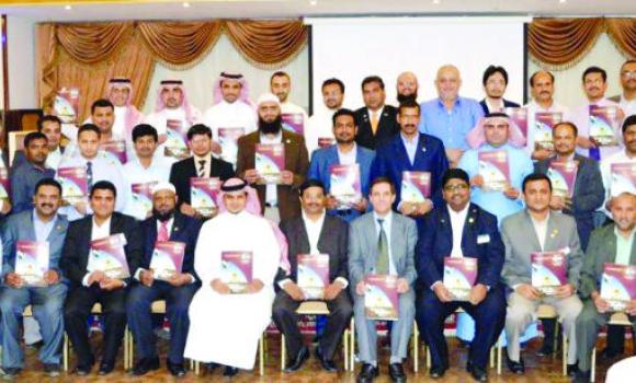 Members of ALJ Talkmasters Club with senior officials of Toastmasters Clubs in Jeddah following the launching of their magazine.