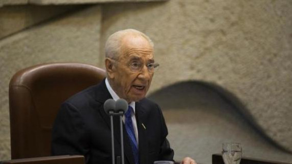 Outgoing Israeli President Shimon Peres speaks during the swearing-in ceremony of incoming President Reuven Rivlin at the Knesset, Israel's parliament, in Jerusalem July 24, 2014.