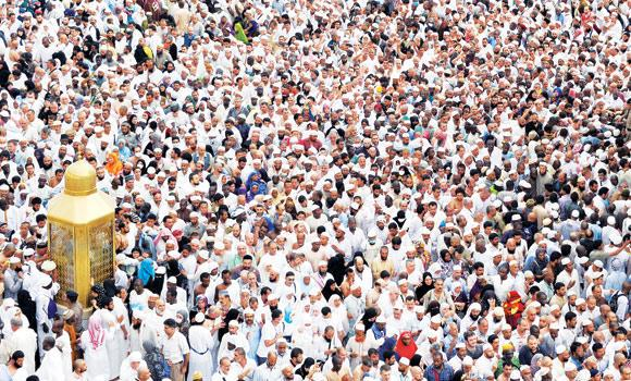 People gather in Haram ahead of Friday prayer.