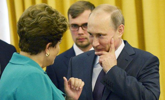 Russia's President Vladimir Putin (R) speaks with Brazil's President Dilma Rousseff during a meeting in Rio de Janeiro, on Sunday.