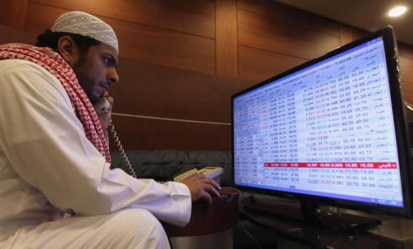 Saudi trader monitors stocks