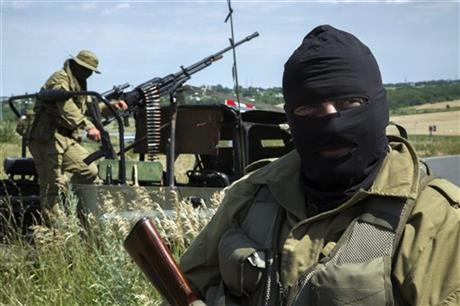 Pro-Russian fighters stand in their positions, as they patrol the airspace near Luhansk, eastern Ukraine.