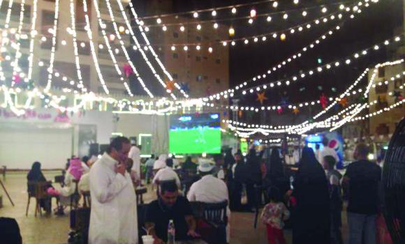 Football fans watch the World Cup match between Algeria and Germany in the Balad area on Monday night.