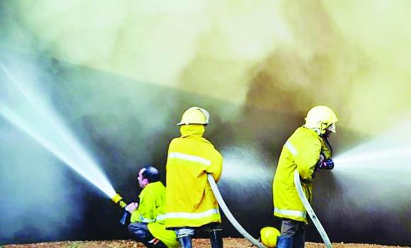 Firefighters battle the blaze at Chemanol company in Jubail Industrial City.