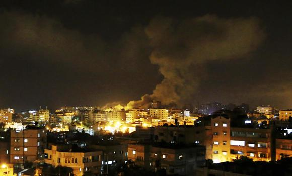 Smoke rises after an Israeli missile strike hit Gaza City on Thursday after Palestinian militants fired rockets into Israel. Israeli officials said they were also moving troops to Gaza.