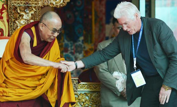 US actor Richard Gere (R) shakes hands with Tibetan spiritual leader, the Dalai Lama, to greet him on his 79th birthday at Choglamsar, about 10 kilometers from Leh, Ladakh on Sunday.