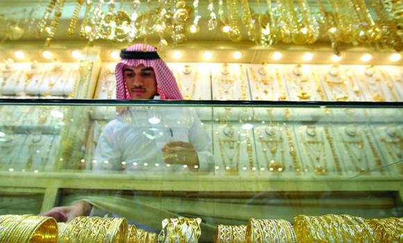 A salesman arranges gold bangles.