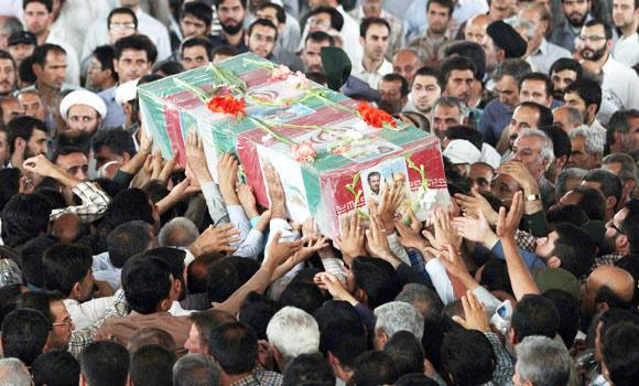 A handout image made available by Iran's FARS News Agency on July 5, 2014, shows mourners attending the funeral of an Iranian pilot at a mosque in the city of Shiraz, on Friday.