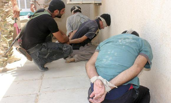Iraqi security forces detain men suspected of being militants of the Islamic State in Diyala province on July 15, 2014. A Saudi mufti with the Islamic State (IS or Daesh) and four others were reported to have been killed in an air raid on July 16 in Baiji, Tikrit.
