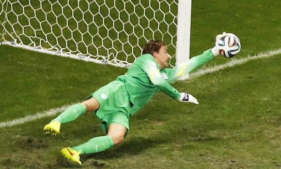 Goalkeeper Tim Krul of the Netherlands makes a save on a shot at goal by Costa Rica's Michael Umana (unseen) during a penalty shootout in their 2014 World Cup quarter-finals at the Fonte Nova arena in Salvador on Saturday.