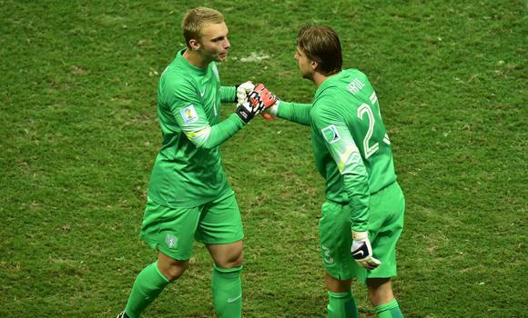 Netherlands' Jasper Cillessen (L) is substitued for Tim Krul.