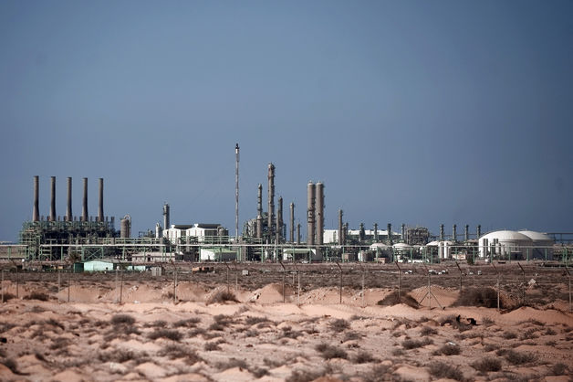 Libya is now producing about 320,000 barrels a day, or about a fifth of its output before Qaddafi was overthrown in 2011, according to state-run National Oil Corp.