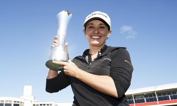 Mo Martin of the US poses for photographs after winning the women's British Open golf tournament at the Royal Birkdale Golf Club in Southport, northern England, on Sunday.