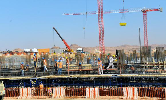In this March 2014 file photo, construction workers are seen at a government project in Sakaka. Under a Ministry of Labor rule that is in effect from June 15 to Sept. 15, 2014, companies are forbidden from making laborers work under the sun from 12 noon to 3 p.m.