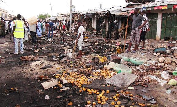 People gather at the scene of a car bomb explosion, at the central market, in Maiduguri, Nigeria, in this July 2, 2014 photo.